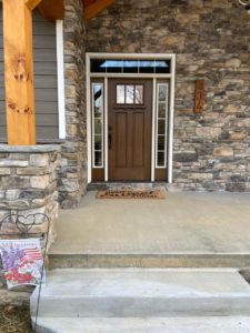 MTB Windows and More mountain home renovation, new exterior door and stone siding